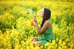 Woman start soap bubbles Royalty Free Stock Images
