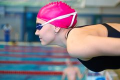 Woman on start of swimming. Young woman leaning at the start before the swimming pool Stock Photography
