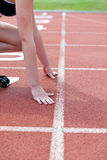 Woman on the starting block Stock Photo