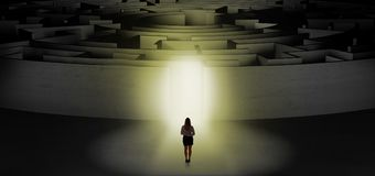 Woman starting a concentric labyrinth Stock Photography