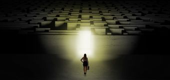 Woman starting a dark labyrinth challenge stock images