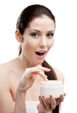Woman starting to apply smoothing cream Stock Photo