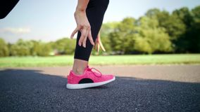 Woman starting up her jogging training. Close up of woman starting up her jogging training stock video