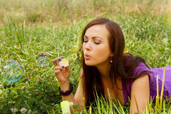 Woman  starts soap bubbles Royalty Free Stock Image