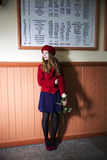 Woman at station with rose at hand Royalty Free Stock Photography