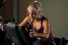 Woman on Stationary Bike Royalty Free Stock Photos