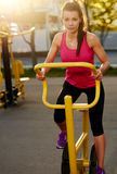 Woman on a stationary bike outside. Stock Photography