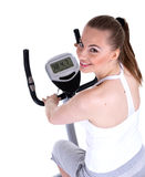 Woman on stationary training bicycle Stock Photos