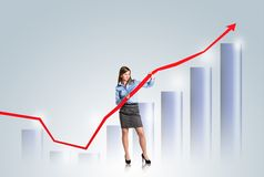 Woman with statistics curve Stock Image