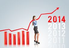 Woman with statistics curve Stock Images