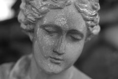 Woman Statue. Statues with water like tears in black and white royalty free stock photo