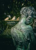 Woman Statue With Bird Bath Royalty Free Stock Image