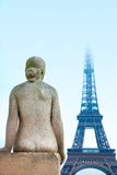 Woman statue and Eiffel Tower Royalty Free Stock Image
