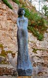 Woman statue in Eze village near church building Stock Images