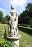 Woman statue at a formal garden Stock Photo
