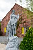 Woman statue in the garden royalty free stock photo