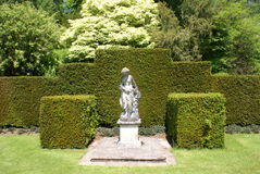 Woman statue. hedges. topiary trees Stock Photos