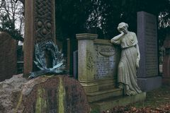 Woman statue leaning on tomb in Dean Cemetery, Edinburgh stock photos