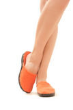 Woman stay in bright orange slippers Royalty Free Stock Photos