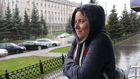 A woman stay on the street and freezes. It`s raining stock video