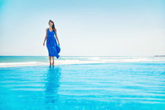Woman staying at the pool stock images