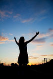 Woman staying with raised hands Royalty Free Stock Photography