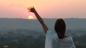 Woman staying at the sunset time stock footage