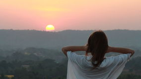 Woman staying at the sunset time stock video footage
