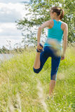 Woman stays outdoor in the morning sport workout. Stock Photos