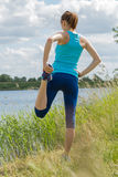 Woman stays outdoor in the morning sport workout. Royalty Free Stock Images