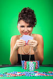 Woman stays at poker table Royalty Free Stock Photo