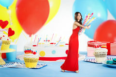Woman stealing candles from a cake Royalty Free Stock Photography