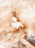 Woman in steamed finnish sauna Royalty Free Stock Photo