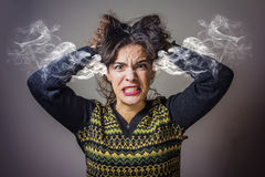 Woman steaming with rage Stock Photos