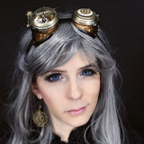 Woman with steampunk glasses Stock Photos