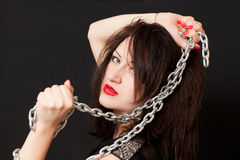 Woman and a steel chain Royalty Free Stock Image
