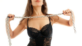 Woman and a steel chain. Seductive young woman holding a steel chain on a white background stock photography