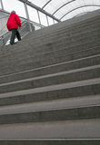 Woman on steep stairs Stock Image