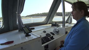 Woman Steering Boat stock video