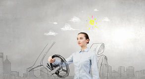 Woman with steering wheel Royalty Free Stock Photos