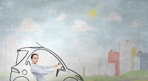 Woman with steering wheel Stock Images