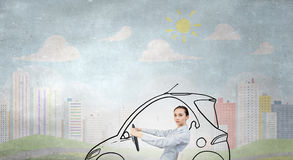 Woman with steering wheel Stock Photography