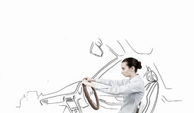Woman with steering wheel Stock Photo