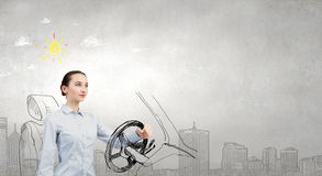 Woman with steering wheel Royalty Free Stock Photo