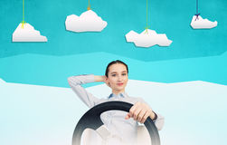 Woman with steering wheel. Young smiling pretty woman driving steering wheel Stock Images