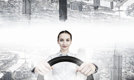 Woman with steering wheel. Young smiling pretty woman driving steering wheel Stock Photos