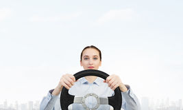Woman with steering wheel Royalty Free Stock Image