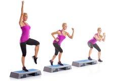 Woman step aerobics exercise Stock Image