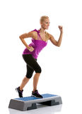 Woman step aerobics exercise Royalty Free Stock Photos
