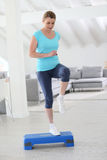 Woman step excercising at home Royalty Free Stock Photos
